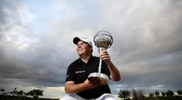 Shane Lowry holds his trophy after winning the Portugal Masters 2012 golf tournament at the Victoria golf course in Vilamoura, southern Portugal. Photo: AP