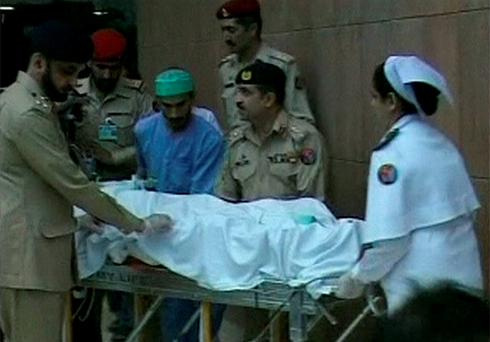 Malala Yousufzai is brought out of a hospital on a stretcher in Rawalpindi