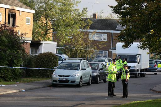 Police at the scene following a fire at Barn Mead in Harlow Essex, where woman and three young children died and two other people are in hospital after a house fire. Photo: PA