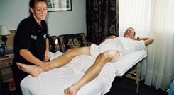 Emma O'Reilly giving a massage to Lance Armstrong in 1999