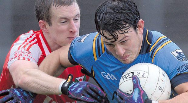 Salthill-Knocknacarra's Sean Armstrong fends off David Connern of Tuam in the Galway SFC final
