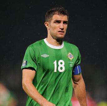 Aaron Hughes believes his side will have to be disciplined to cope with Portugal keeping the ball for long spells