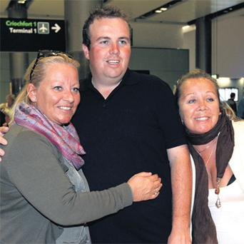 Portugal Masters winner Shane Lowry is greeted by fans as he flew into Dublin airport