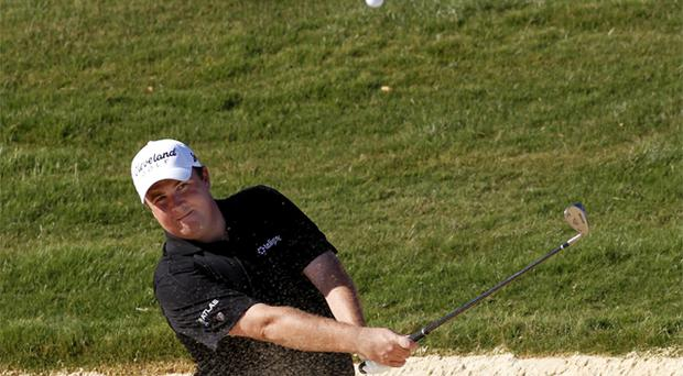 Shane Lowry plays a shot from a bunker on his way to victory in the Portugal Masters