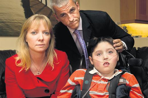 Linda and Anthony Duffy with their son Mark at their home in Cabinteely, Dublin, after a court awarded the HSE its costs against them after the failed negligence case they took against Holles Street Hospital. Photo: Mark Condren