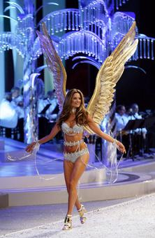 Angel Alessandra Ambrosio walks the runaway wearing the 2008 Fantasy Bra.