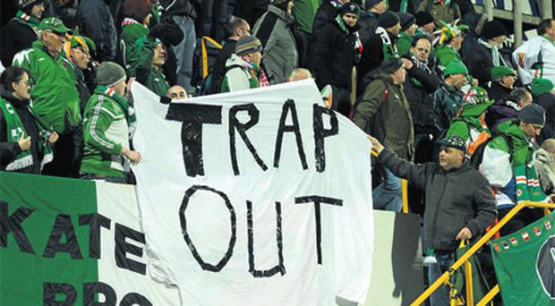 Irish fans hold a banner calling for Trapattoni's head at last night's game