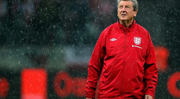 Roy Hodgson looks on during the rain before the FIFA 2014 World Cup Qualifier between Poland and England. Photo: Getty Images