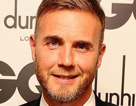 File photo dated 04/09/12 of Gary Barlow who has lined up his first solo tour for 13 years with a string of dates beginning next month. PRESS ASSOCIATION Photo. Picture date: Monday October 15, 2012. The Take That star has announced 16 shows, with songs from his entire career, which he will fit around his X Factor commitments. See PA story SHOWBIZ Barlow. Photo credit should read: Ian West/PA Wire