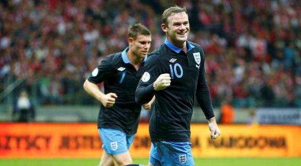England's Wayne Rooney celebrates his goal against Poland during their World Cup 2014 qualifying soccer match at the National Stadium in Warsaw October 17, 2012. REUTERS/Darren Staples (POLAND - Tags: SPORT SOCCER ENVIRONMENT)