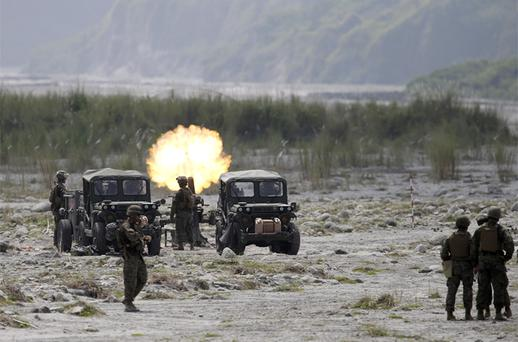 U.S. Marines and their Philippine counterpart fire mortars at a target during a live-fire exercise in the ongoing Philippines-US amphibious landing exercise dubbed Phiblex 2013 at Crow Valley, Tarlac