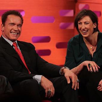 Arnold Schwarzenegger and Miranda Hart during filming of The Graham Norton Show