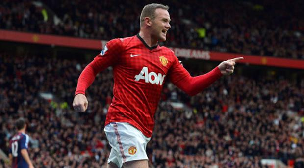 Manchester United's Wayne Rooney celebrates scoring against Stoke City during their English Premier League soccer match in Manchester, northern England October 20, 2012. REUTERS/Nigel Roddis (BRITAIN - Tags: SPORT SOCCER) NO USE WITH UNAUTHORIZED AUDIO, VIDEO, DATA, FIXTURE LISTS, CLUB/LEAGUE LOGOS OR