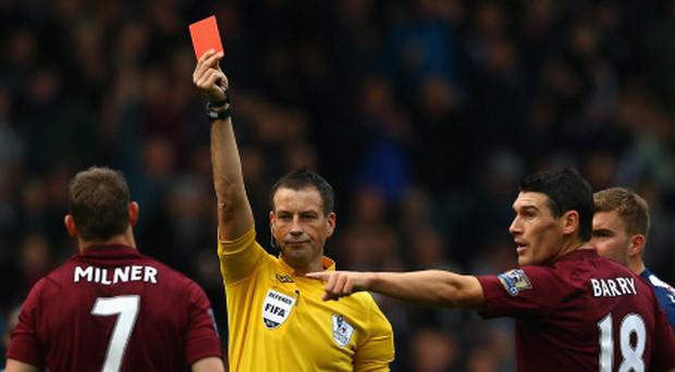 WEST BROMWICH, ENGLAND - OCTOBER 20: James Milner of Manchester City is sent off by referee Mark Clattenberg, after his tackle on Shane Long of West Bromwich Albion during the Barclays Premier League match between West Bromwich Albion and Manchester City at The Hawthorns on October 20, 2012 in West Bromwich, England. (Photo by Matthew Lewis/Getty Images)