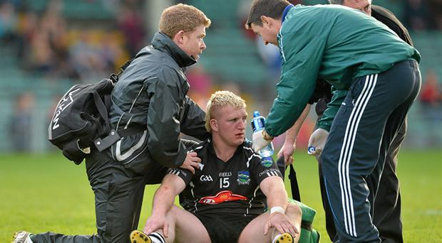 James Kelly of Newcastlewest receives attention following the incident