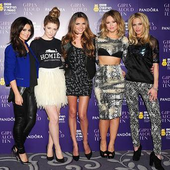 Girls Aloud have announced that they will reunite for a tour