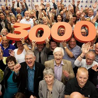 Winners gather to celebrate the National Lottery reaching the landmark of 3,000 millionaires in the UK since its launch in 1994