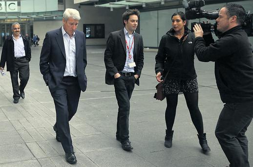 'Newsnight' presenter Jeremy Paxman (third left) leaves BBC HQ in London ahead of the broadcasting of new allegations about how 'Newsnight' handled claims of sex abuse by Jimmy Savile