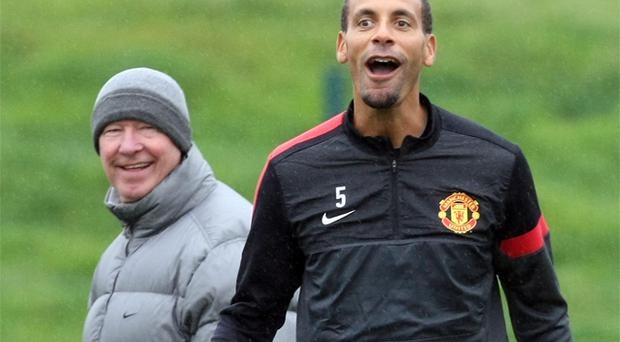 Rio Ferdinand and Alex Ferguson were all smiles again during yesterday's training session at Carrington