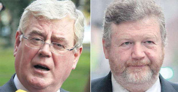 Tanaiste Eamon Gilmore (left) and Health Minister James Reilly (right).