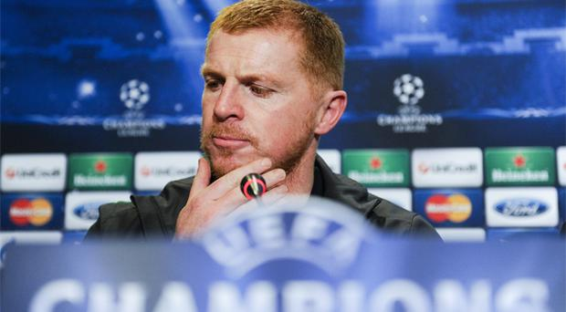 Neil Lennon answers questions at a press conference ahead of tonight's game against Barcelona