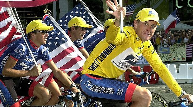 Distant glory: Lance Armstrong rides down the Champs Elysees with team-mates Georges Hincapie and Tyler Hamilton after winning the 2001 Tour de France. Photo: AP
