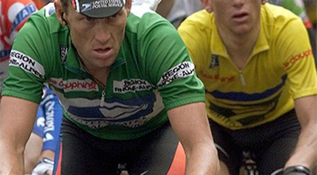 Compatriots Lance Armstrong and Tyler Hamilton (yellow jersey) pictured in June, 2000