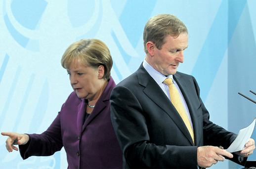 Chancellor Angela Merkel and Enda Kenny: 'Dr Merkel's comments are effectively meaningless. What happens if, having 'examined' Irish debt problems, the authorities decide to do nothing?' Photo: Getty Images