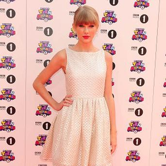 Taylor Swift says she hasn't been signed up yet to play Joni Mitchell on the big screen