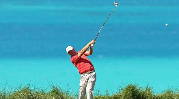 SOUTHAMPTON, BERMUDA - OCTOBER 23: Padraig Harrington of Ireland hits his tee shot on the ninth hole during the PGA Grand Slam of Golf at Port Royal Golf Course on October 23, 2012 in Southampton, Bermuda. (Photo by Mike Ehrmann/Getty Images)