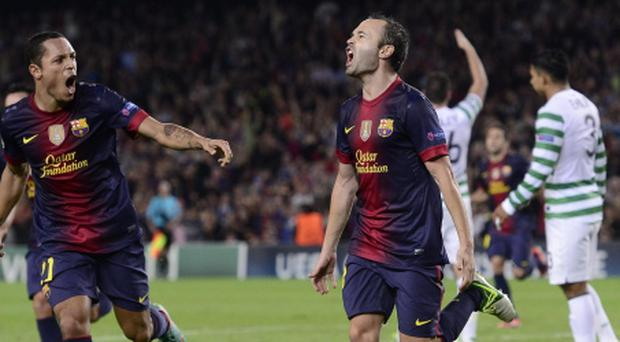 FC Barcelona Andres Iniesta, center, reacts after scoring during a Champions League soccer match group G against Celtic at the Camp Nou in Barcelona, Spain, Tuesday, Oct. 23, 2012. (AP Photo/Manu Fernandez)