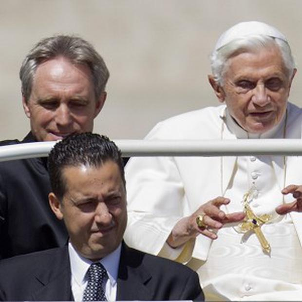 The pope's butler, bottom left, has been accused of harming the entire Catholic church (AP)