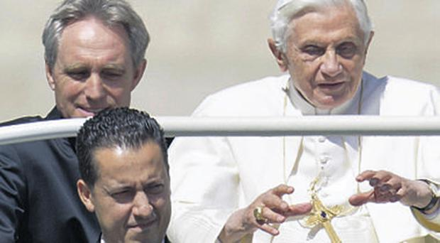 Paolo Gabiele (front) with Pope Benedict; the Vatican insists secrecy is critical for the Pontiff.