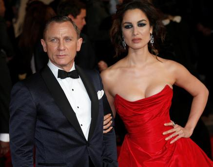 Actor Daniel Craig and actress Berenice Marlohe pose for photographers as they arrive for the royal world premiere of the new 007 film