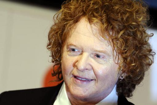 British singer Mick Hucknall of the band Simply Red poses on the red carpet upon arriving for the 45th Goldene Kamera award ceremony in Berlin on January 30, 2010. The
