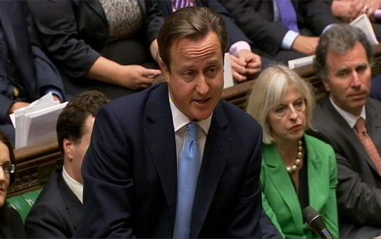 British Prime Minister David Cameron speaks during Prime Minister's Questions