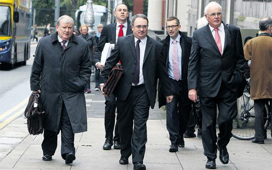 The NAMA team on their way to a meeting with the Finance Committee in Leinster House yesterday included, from front left, head of asset recovery Ronnie Hanna, chief executive Brendan McDonagh, and chairman Frank Daly