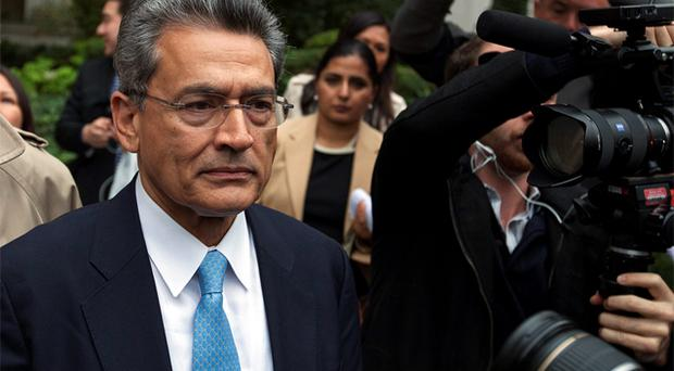 Former Goldman Sachs Group Inc board member Rajat Gupta departs Manhattan Federal Court after being sentenced in New York. Photo: Reuters