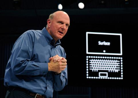 LOS ANGELES, CA - JUNE 18: Microsoft CEO Steve Ballmer shows the new tablet called Surface during a news conference at Milk Studios on June 18, 2012 in Los Angeles, California. The new Surface tablet has a 10.6 inch screen complete with cover that contains a full multitouch keyboard. (Photo by Kevork Djansezian/Getty Images)