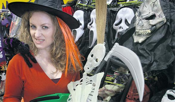 Tina Leonard with her Halloween goodies in Dealz at West End retail park, Blanchardstown. Photo: Ronan Lang