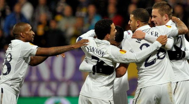 Tottenham Hotspur's Gylfi Sigurdsson (R) celebrates with teammates after scoring against Maribor during their Europa League Group J match in Maribor October 25, 2012. REUTERS/Srdjan Zivulovic (SLOVENIA - Tags: SPORT SOCCER)