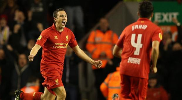 LIVERPOOL, ENGLAND - OCTOBER 25: Stewart Downing of Liverpool celebrates scoring the opening goal during the UEFA Europa League Group A match between Liverpool FC and FC Anzhi Makhachkala at Anfield on October 25, 2012 in Liverpool, England. (Photo by Clive Brunskill/Getty Images)