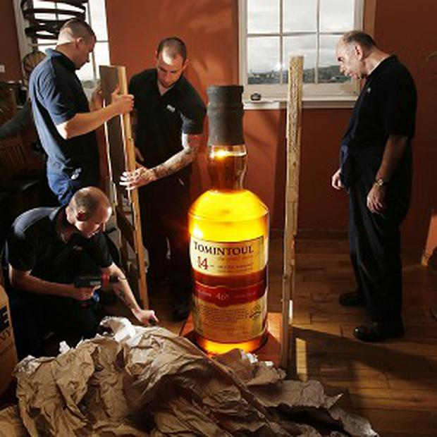 The world's largest bottle of single malt whisky is unboxed at The Scotch Whisky Experience in Edinburgh