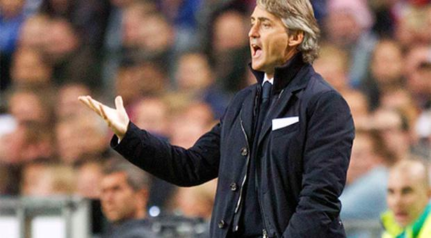 Manchester City's manager Roberto Mancini reacts during their Champions League defeat at Ajax
