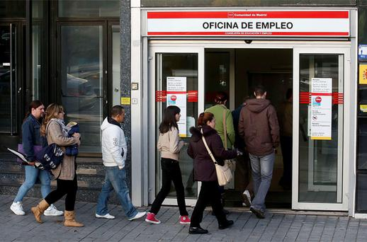 People enter a government-run employment office in Madrid. Photo: Reuters