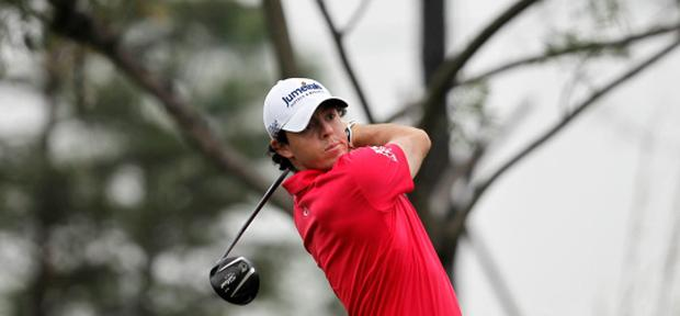 Rory McIlroy of Northern Ireland tees off on the third hole during the third round of the BMW Masters 2012 golf tournament at Lake Malaren Golf Club in Shanghai, October 27, 2012. REUTERS/Aly Song (CHINA - Tags: SPORT GOLF)