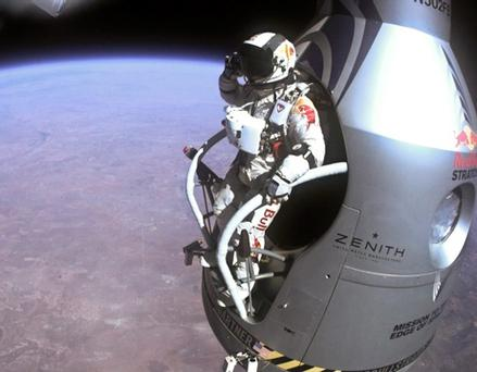 Pilot Felix Baumgartner of Austria salutes as he jumps out of the capsule during the final manned flight for Red Bull Stratos in Roswell, New Mexico in this October 14, 2012 handout photograph. Baumgartner, 43, leapt into the stratosphere from a balloon near the edge of space 24 miles (38 km) above Earth on October 14, 2012 and safely landed, setting a record for the highest skydive and breaking the sound barrier in the process. Picture taken October 14, 2012. REUTERS/Red Bull Stratos/Handout (UNITED STATES - Tags: SCIENCE TECHNOLOGY TRANSPORT SOCIETY) NO SALES. NO ARCHIVES. FOR EDITORIAL USE ONLY. NOT FOR SALE FOR MARKETING OR ADVERTISING CAMPAIGNS. THIS IMAGE HAS BEEN SUPPLIED BY A THIRD PARTY. IT IS DISTRIBUTED, EXACTLY AS RECEIVED BY REUTERS, AS A SERVICE TO CLIENTS