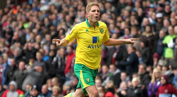 Norwich City's Michael Turner celebrates scoring his side's first goal of the game during the Barclays Premier League match at Villa Park, Birmingham. PRESS ASSOCIATION Photo. Picture date: Saturday October 27, 2012. See PA story SOCCER Villa. Photo credit should read: David Davies/PA Wire. RESTRICTIONS: Editorial use only. Maximum 45 images during a match. No video emulation or promotion as 'live'. No use in games, competitions, merchandise, betting or single club/player services. No use with unofficial audio, video, data, fixtures or club/league logos.