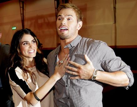 Nikki Reed and Kellan Lutz (right) meet fans at an event for the film Twilight Saga: Breaking Dawn Part II at The Convention Centre, Dublin. PRESS ASSOCIATION Photo. Picture date: Saturday October 27, 2012. Photo credit should read: Julien Behal/PA Wire