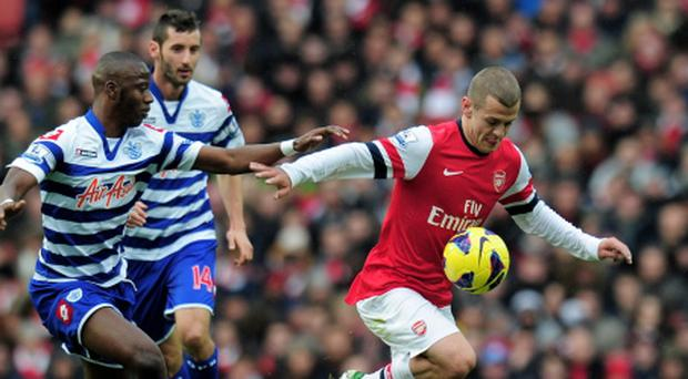 LONDON, ENGLAND - OCTOBER 27: Jack Wilshere of Arsenal goes past the challenge from Samba Diakite of QPR during the Barclays Premier League match between Arsenal and QPR at The Emirates Stadium on October 27, 2012 in London, England. (Photo by Shaun Botterill/Getty Images)